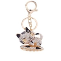 Pussy Stoned Metal Keychain