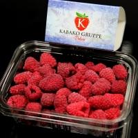 Frozen Raspberries In Plastic Box Isolated